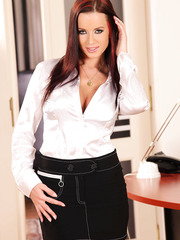 Awesome-looking milf Cindy Dollar is posing with spread legs on the table