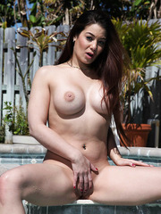 Tattooes babe Ryder Skye showing big tits and shaved pussy at the pool