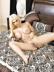 Nice blonde Carmel Moore playing with trimmed pussy and teasing big tits