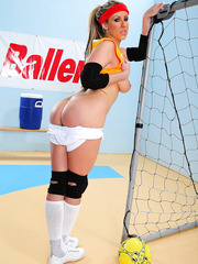 Naughty babe Carolyn Reese showing big tits and playing with a ball