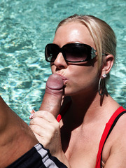 Dazzling chick Britney Brooks swimming in pool and making a deep blowjob