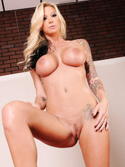 Tall milf Brooke Banner showing hot tattoes and fingering shaved vagina