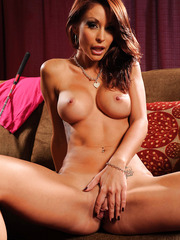 Unmatched whore Monique Alexander showing delicious tits and posing on the sofa