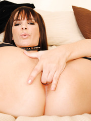 Curious chick Dana DeArmond posing in black lingerie and playing with pussy