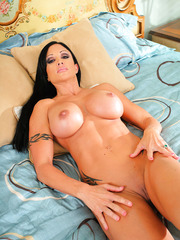 Wonderful milf Jewels Jade posing in pink lingerie and fingering in her bedroom