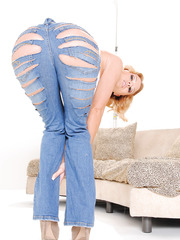 Cheeky blonde Krissy Lynn taking off jeans and showing her delicious butt