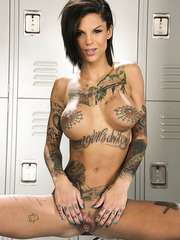 Booty minx Bonnie Rotten showing tattooed body and masturbating hard