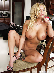 Glamorous milf Shyla Stylez shows off her huge tits and shaved pussy