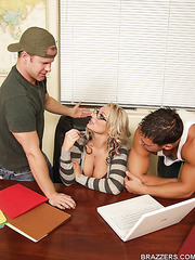 Busty librarian Kate Frost fucked by two hungry students right on the table