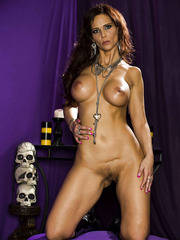 Elegant and sumptuous lady Syren De Mer takes off her rich lingerie