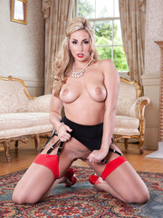 Delicious blonde slut Paige Turnah poses in hot stockings and perfect high heels