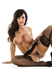 Perfect milf Lisa Ann takes of her beautiful bra and hot panties to pose on the camera