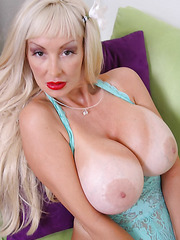 Fantastic mature blonde Britney O'Neil amazes with her giant tits and wild passion