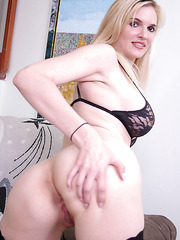 Sexy blonde milf named Nina takes off her lingerie to show her big tits and alluring pussy