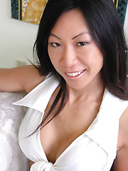 Asian brunette babe Tia Ling demonstrates her perfect round plump tits