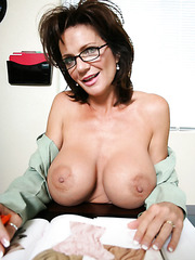 Mature business lady on sexy high heels Deauxma gets naked and shows her big tits