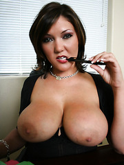 Appetizing mature brunette Claire Dames treats us with her giant melons