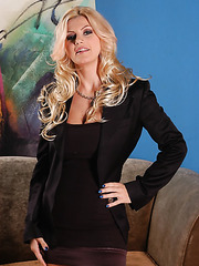 Glamorous milf with big boobs and shaved pussy Brittany Andrews strips on the camera
