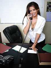 Sexy office lady Ryder Skye teases with her sexy figure, big round tits and shaved pussy