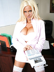 Tanned blonde milf Rhyse Richards demonstrates her big boobs and masturbates