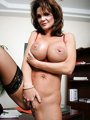 Busty brunette mature Deauxma shows you her huge tits and a shaved pussy