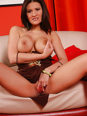 Busty brunette lady Austin Kincaid demonstrates her delicious boobs