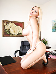 Amazing blonde milf Nikki Benz takes off her panties and shows a juicy hole