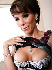Slutty mature Kayla Synz rubs her boobs and plays with a shaved pussy