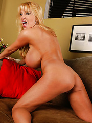 Harmony Bliss undresses her sexy clothes and demonstrates huge delicious boobs