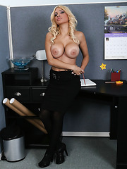 Beautiful blonde milf Carmel Moore shows her hairy pussy and masturbates