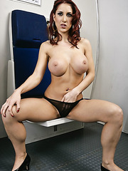 Redhead babe Kylee Strutt shows her great naked body on the plane