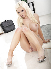 Busty blonde bitch Delta White shows her pretty pussy and big tits