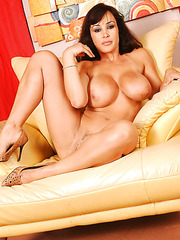 Perfect milf Lisa Ann shows off her fabulous big boobs and sweet pussy