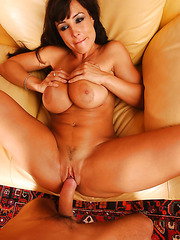 Dark haired milf with sexy lips Lisa Ann treats lucky boy with her big boobs and wet pussy