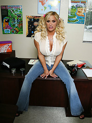 Sexy blonde babe with big tits Shyla Stylez takes off her jeans to show shaved pussy