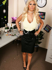 Glamorous blonde milf Bridgette B poses naked after hot office party