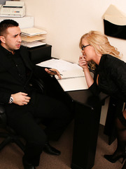 Busty blonde milf Dylan Riley remains alone with lucky man in the office