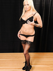 Remarkable blonde Lylith Lavey remains in her stockings and high heels only