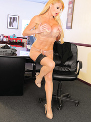 Glamorous bombshell Taylor Wane peels off super sexy lingerie and poses