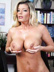 Excellent mature hottie Kristal Summers demonstrates her big tits and caresses pussy