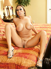 Long haired and big titted babe Sophia Lomeli spreads her long legs on the camera