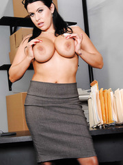 Strict-looking milf Lacie James takes off her office-style uniform and caresses pussy