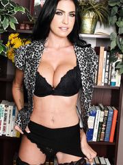 Elegant and beautiful brunette milf Emmanuelle London with great long legs and hot big tits