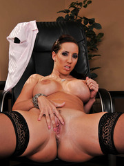 Sexy and busty secretary Kelly Divine undresses and shows her trimmed pussy