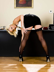 Elegant blonde whore Lexi Swallow undresses her sexy clothes for you