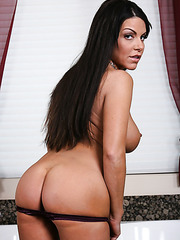 Gorgeous brunette babe Victoria Valentino strips in the bathroom