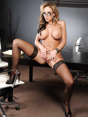 Excellent milf in sexy stockings spreads her delicious legs and plays with big tits