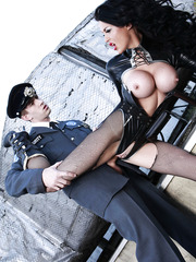 Buxom milf in tight latex uniform Stacey Lacey seduces young security man