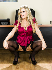Gorgeous blonde Darcy Tyler takes off her skirt and lingerie to amaze us