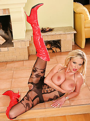 Blonde mistress Sharon Pink poses in sexy panthose, red high heels and sweet lingerie